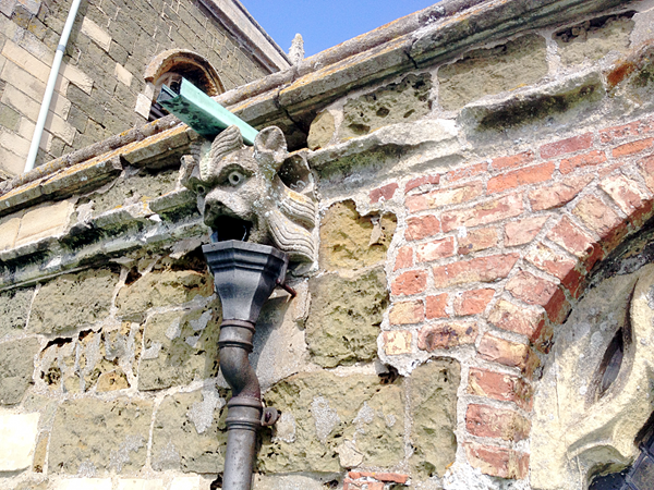 Inadequate rainwater disposal and eroding stonework